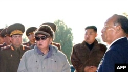 North Korean dictator Kim Jong Il (in sunglasses) visiting the cemetery of fallen fighters of the Chinese People's Volunteers with son Kim Jong Un (second from right),who's been tabbed as a possible successor, in October.