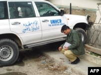 A police officer inspects the site where John Solecki was kidnapped in Quetta.
