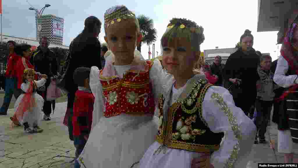 Children wear Albanian national dress in Tirana.