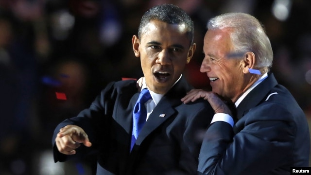 U.S. President Barack Obama and Vice President Joe Biden celebrate their election victory in Chicago early on November 7.