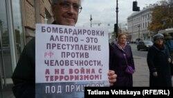 Участники пикетов обвинили Россию в военных преступлениях в Сирии
