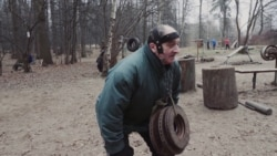 Working Out With Manhole Covers In Moscow's Woods