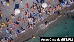 """Vacationers on a beach in Gagra, Akhazia. Tourism is called the """"locomotive"""" of Abkhazia's economy and the number of visitors to the region is expected to grow by 15 to 20 percent over the 1.5 million people whocame last year --already more than six times the population of the region."""