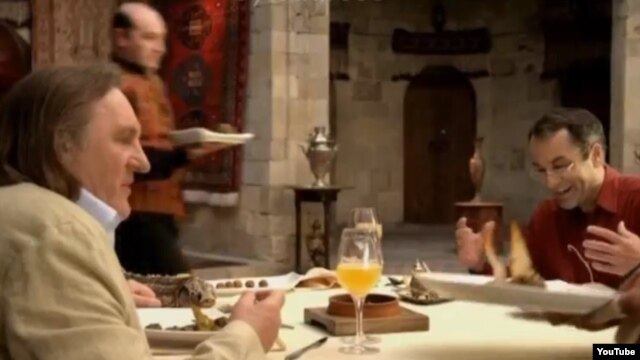 "Gerard Depardieu (left) raves about the food in the ""Azerbaijani Cuisine"" television commercial, saying it's ""obviously a smart country."""