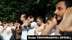 Акция в поддержку задержанных фоторепортеров