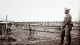 An archive picture shows a French officer standing near a cemetery with recent graves of soldiers killed on the front lines of World War One (WWI), at Saint-Jean-sur-Tourbe on the Champagne front, eastern France December 19, 1916. A Viscount in