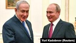 Израиль премьер-министрі Биньямин Нетаньяху мен Ресей президенті Владимир Путин. Мәскеу, 11 шілде 2018 жыл.