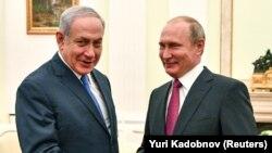 Kryeministri izraelit, Benjamin Netanyahu dhe presidenti rus, Vladimir Putin. Foto nga arkivi.