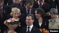 Russian President Dmitry Medvedev (center) poses with Russian Olympians after an awards ceremony in the Kremlin on March 15.