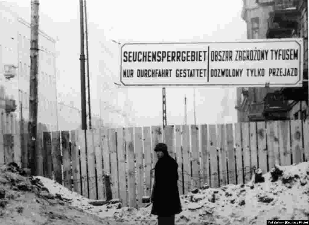 A sign in the ghetto forbids entrance to the area quarantined for typhus sufferers.