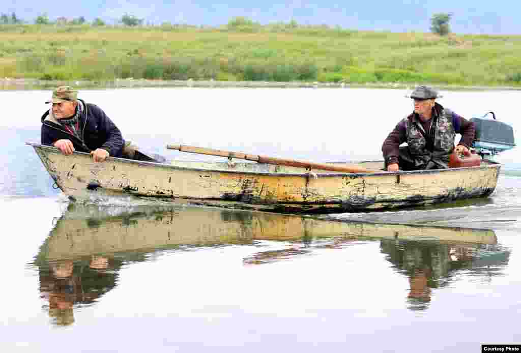 Fishermen travel across Lake Issyk-Kul, the site of some of Kyrgyzstan's fish farms.