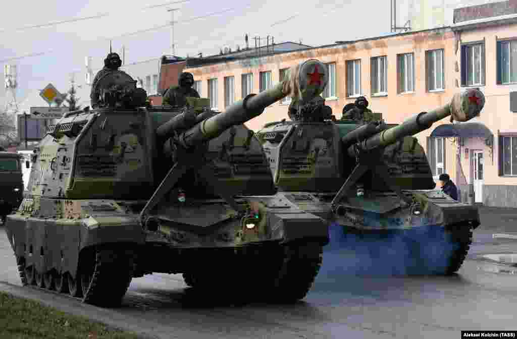 Russian servicemen drive self-propelled howitzers along a street in Yekaterinburg. Officials are considering holding Victory Day events without veterans, who could be more vulnerable to the coronavirus.