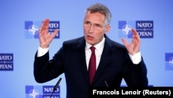 NATO Secretary-General Jens Stoltenberg speaks to reporters in Brussels on October 3.