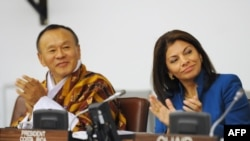 "Bhutan's Prime Minister Jigmi Y. Thinley (left) and Costa Rican President Laura Chinchilla at this week's high-level United Nations panel discussion on ""Happiness and Well-Being"""