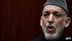 Afghan President Hamid Karzai has insisted his appointees should spearhead any talks with the Taliban.