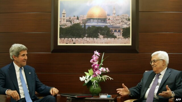 U.S. Secretary of State John Kerry (left) meets with Palestinian Authority President Mahmud Abbas on July 19 in the West Bank city of Ramallah.