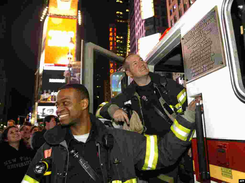 New York City firefighters gather in Times Square to celebrate the announcement.