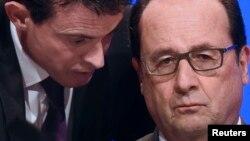 Премьер-министр и президент Франции – Мануэль Вальс (слева) и Франсуа Олланд