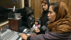 Two Afghan women work in a studio of Voice of Women, the first radio station in Afghanistan to be dedicated to the interests of women, in Kabul in 2005.