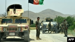 Afghan National Army soldiers patrol the Shah Wali Kot district of Kandahar Province.