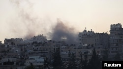 Syria -- Smoke rises from Aleppo's Saif al-Dawla district, 21Aug2012