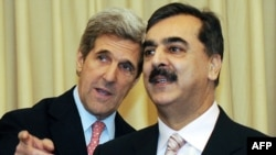 U.S. Senator John Kerry (left) with Pakistani Prime Minister Yousaf Raza Gilani in Islamabad in December 2008