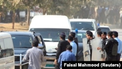 A vehicle carrying Muhammad Safdar, son-in-law of ousted Pakistani premier Nawaz Sharif, arrives at National Accountability Bureau (NAB) court in Islamabad on October 9.