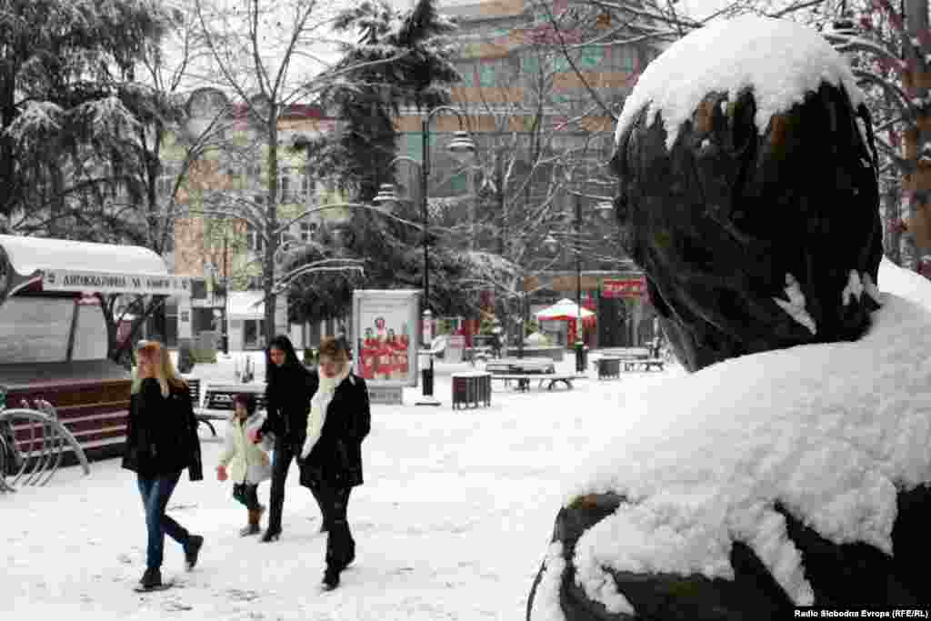 Pedestrians brave the cold in the Macedonian capital, Skopje.