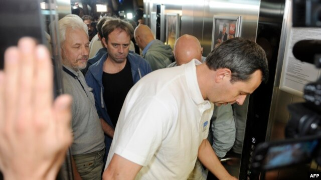 The first team of OSCE observers arrive at a hotel in Donetsk after being freed on June 27.