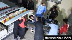 Pakistani medical workers transport an injured Shi'ite Muslim to a hospital in Quetta on September 10.