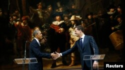 АҚШ президенті Барак Обама (сол жақта) мен Нидерланд премьер-министрі Марк Рютте. Амстердам, 24 наурыз 2014 жыл.