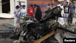 بقايا سيارة مفخخة إنفجرت في الكمالية ببغداد في 13/5/2013