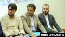 Ammar Salehi, (first from R), with his co-defendants during his corruption trial. Undated.