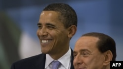 U.S. President Barack Obama and Italian Prime Minister Silvio Berlusconi at the start of the G8 summit