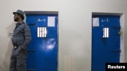 Afghanistan - An Afghan policeman stands in front of cells in a prison in the town of Lashkar Gah in Helmand province, southern Afghanistan, 19Jul2011