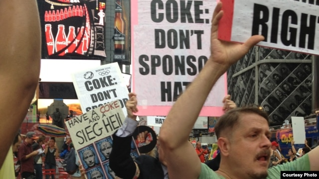 Gay-rights protesters in New York's Times Square call on Coca-Cola to drop its sponsorship ahead of the Winter Olympics in Sochi. (photo courtesy of RUSA LGBT)