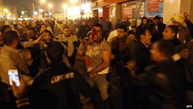 Supporters of the president and the opposition clashed violently in Cairo on December 5.