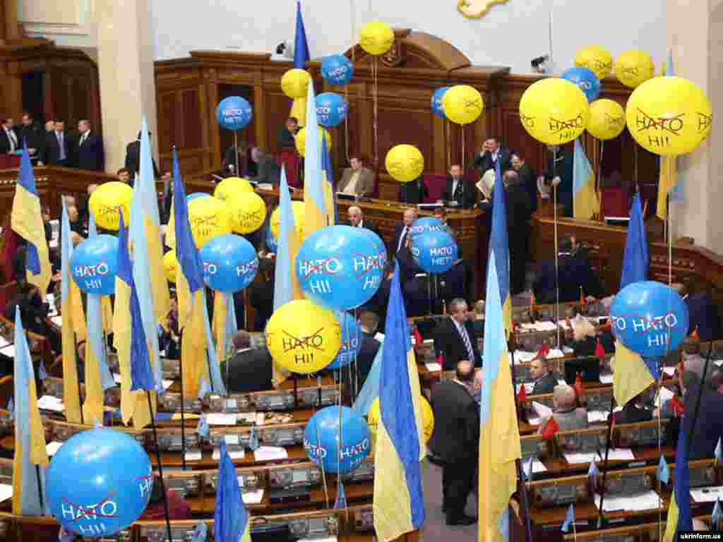 Anti-NATO balloons and national flags in Ukraine's Verkhovna Rada - Decorated with anti-NATO balloons and national flags, Ukraine's parliament yet again failed to convene after deputies of the Party of Regions faction blocked the presidium and rostrum early on February 13.