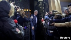Romanian Prime Minister Mihai Tudose leaves a meeting of the ruling Social Democratic Party in Bucharest.