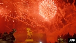 North Korea -- Fireworks explode before the 'Victorious Fatherland War Museum' during a display marking the 60th anniversary of the Korean war armistice agreement, in Pyongyang on July 27, 2013.