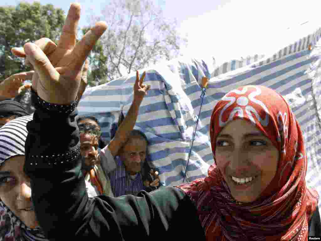 Yemeni Nobel Peace Prize winner Tawakul Karman flashes a victory sign outside her tent on Tagheer Square in Sanaa on October 7. (Photo by Ahmed Jadallah for Reuters)