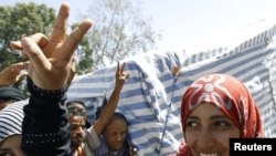 Nobel Peace Prize winner Tawakul Karman flashes a victory sign outside her tent on Tagheer Square in Sanaa on October 7.