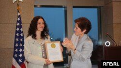 Mariam Sukhudian (left) receives an award from U.S. Ambassador Marie L. Yovanovitch.