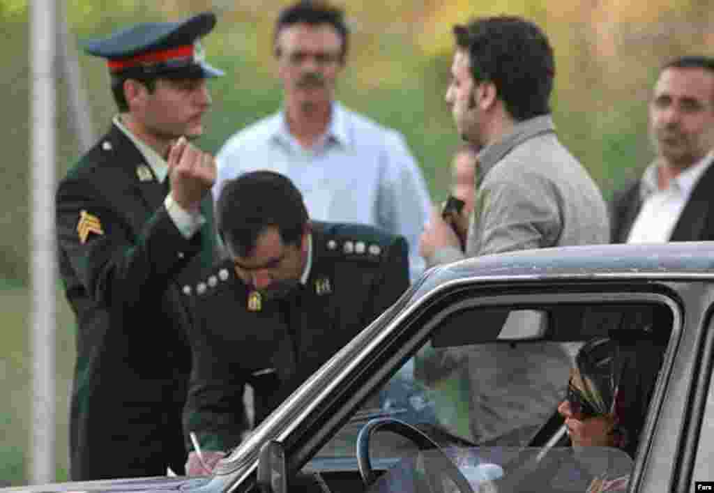Police and Basij activists check women for proper dress in Tehran on April 22 (Fars) - So far this year, thousands of women have received warnings, and many have been detained, for appearing in public in ways deemed inappropriate or immoral. Some observers have reported that this year's crackdown has been pursued with more seriousness and vigor than usual.
