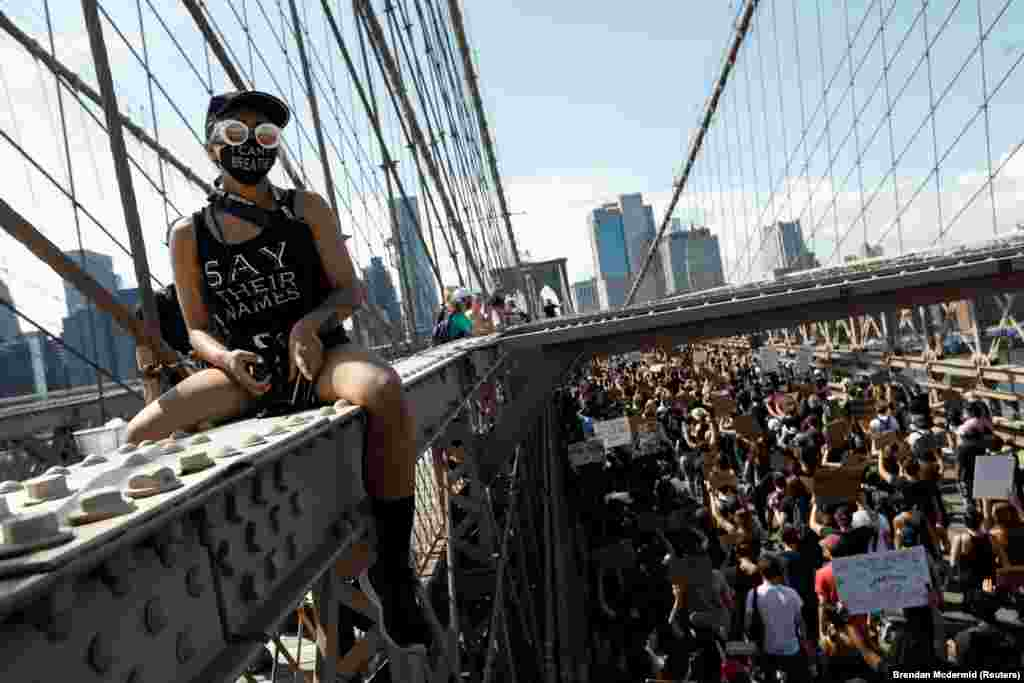 People march during events to mark Juneteenth, which commemorates the end of slavery in Texas, two years after the 1863 Emancipation Proclamation freed slaves elsewhere in the United States, amid nationwide protests against racial inequality, at the Brooklyn Bridge, in New York City, New York, U.S., June 19, 2020.
