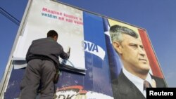 An election billboard of Kosovo Prime Minister Hashim Thaci, who has been accused of playing the lead role in an organ trafficking operation.
