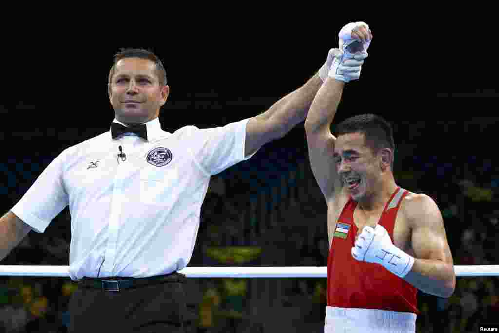 Hasanboy Dusmatov of Uzbekistan reacts after winning his semifinal bout in the men's light fly (49 kilograms) boxing.