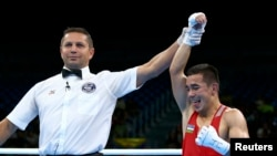 Hasanboy Dusmatov of Uzbekistan reacts after winning his bout over American Nico Miguel Hernandez.