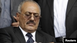 Yemen -- President Ali Abdullah Saleh looks at his watch during a rally in Sanaa, 15Apr2011