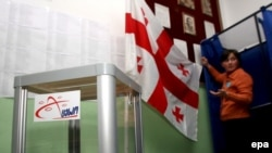 A member of a Georgian voting commission prepares a polling station before the 2008 presidential vote.